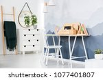 white chair at a desk with...   Shutterstock . vector #1077401807