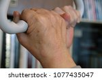 old hands holding a trapeze | Shutterstock . vector #1077435047
