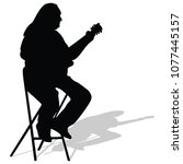 music man sitting on the chair... | Shutterstock .eps vector #1077445157