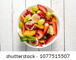 fresh fruit salad in a bowl on... | Shutterstock . vector #1077515507