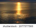 golden light sunset reflecting... | Shutterstock . vector #1077577583
