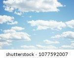 fluffy clouds.closeup blue sky... | Shutterstock . vector #1077592007
