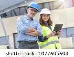 construction engineers meeting...   Shutterstock . vector #1077605603