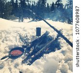 camp fire in the woods in winter | Shutterstock . vector #1077608987