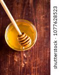 aromatic honey with wooden... | Shutterstock . vector #1077628523