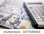 a pile of one hundred us... | Shutterstock . vector #1077650063