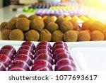assorted chocolate candies in... | Shutterstock . vector #1077693617