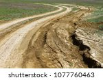 unpaved dry dirt country road...   Shutterstock . vector #1077760463