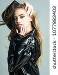 girl with long hair wears black ... | Shutterstock . vector #1077883403