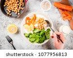 modern vegan food  person eat ...   Shutterstock . vector #1077956813