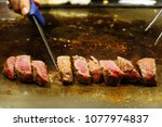 kobe beef being cooked on a hot ... | Shutterstock . vector #1077974837
