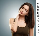 young woman suffering from neck ... | Shutterstock . vector #1077975197