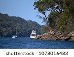 Small photo of Peaceful landscape with pleasure boats and rocky beach, Cowan Creek, Sydney Australia