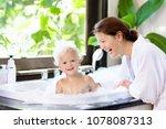 little child taking bubble bath ... | Shutterstock . vector #1078087313