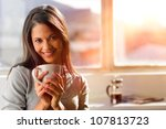 Woman Drinking Coffee At Home...