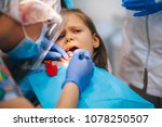 a little girl is curing a tooth ...   Shutterstock . vector #1078250507