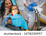 a little girl is curing a tooth ...   Shutterstock . vector #1078250957