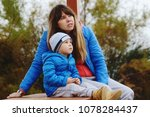 mother and son outdoors are... | Shutterstock . vector #1078284437