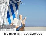 reading a book in beach chair...   Shutterstock . vector #1078289933