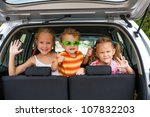 three happy kids in the car | Shutterstock . vector #107832203