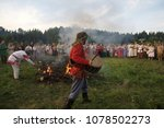 Small photo of Istra.Russia.2010.06.26.Summer solstice. pagan holidays of the Slavs.pagan religion. Shaman beats in a tambourine and a fire is set on fire. People look at the fire. solar solstice. St. John's Day