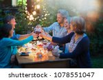 one summer evening  friends in... | Shutterstock . vector #1078551047