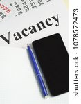 Small photo of Job search, job search. Notebook, calendar, smartphone and pen on the table