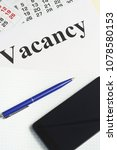 Small photo of Job search, job search. Notebook, calendar, smartphone and pen on the table. Employment opportunity