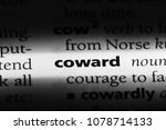Small photo of coward word in a dictionary. coward concept