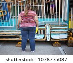 obese woman at a carnival | Shutterstock . vector #1078775087