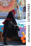 """Small photo of The city of Yalutorovsk, Tyumen region, Russia, April 14, 2018: The Cossack rules his hands with a bent sword. At the festival of Cossack culture """"Krasnaya Gorka"""""""