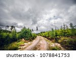 cloudy weather over a dirt road ...   Shutterstock . vector #1078841753