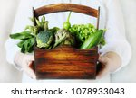 the woman's hands hold a box... | Shutterstock . vector #1078933043
