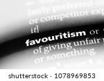 Small photo of favouritism word in a dictionary. favouritism concept