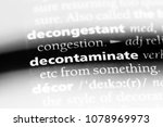 Small photo of decontaminate word in a dictionary. decontaminate concept