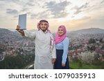 muslim couple using tablet | Shutterstock . vector #1079035913