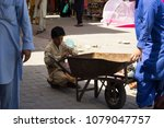 Small photo of Sunday Market, Islamabad , Pakistan - APRIL 24, 2018: Ameer doing child labour in Sunday Market.