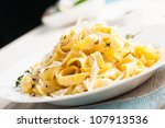 Tagliatelle with parmesan and fresh thyme - stock photo