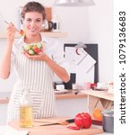 young woman eating fresh salad... | Shutterstock . vector #1079136683
