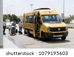 Small photo of Palma International Airport, Mallorca, Spain, 2018. Car hire shuttle bus dropping off passengers at the departures terminal.
