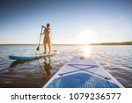 standup paddler at the lake... | Shutterstock . vector #1079236577