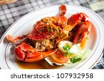 cooked crabs with spicy sauce on white plate (selective Focus) - stock photo