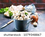 raw mushrooms  raw champignons  ... | Shutterstock . vector #1079348867