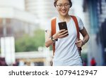 young woman walking with smart... | Shutterstock . vector #1079412947