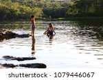 kids in the lake at dunns swamp ... | Shutterstock . vector #1079446067