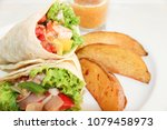asian wrap with king prawns ... | Shutterstock . vector #1079458973