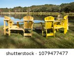 a circle of chairs surrounds a... | Shutterstock . vector #1079477477