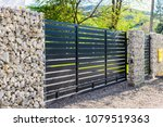 a part of a new metal fence.  | Shutterstock . vector #1079519363