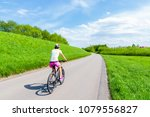 Young Woman Cycling On Rural...