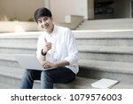 smiling college student sitting ... | Shutterstock . vector #1079576003
